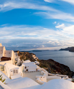 Fenix Traveler-Panorama Oia Village during sunset. Greece Santorini Island